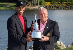 Tiger receives the trophy from golf icon and host Arnold Palmer